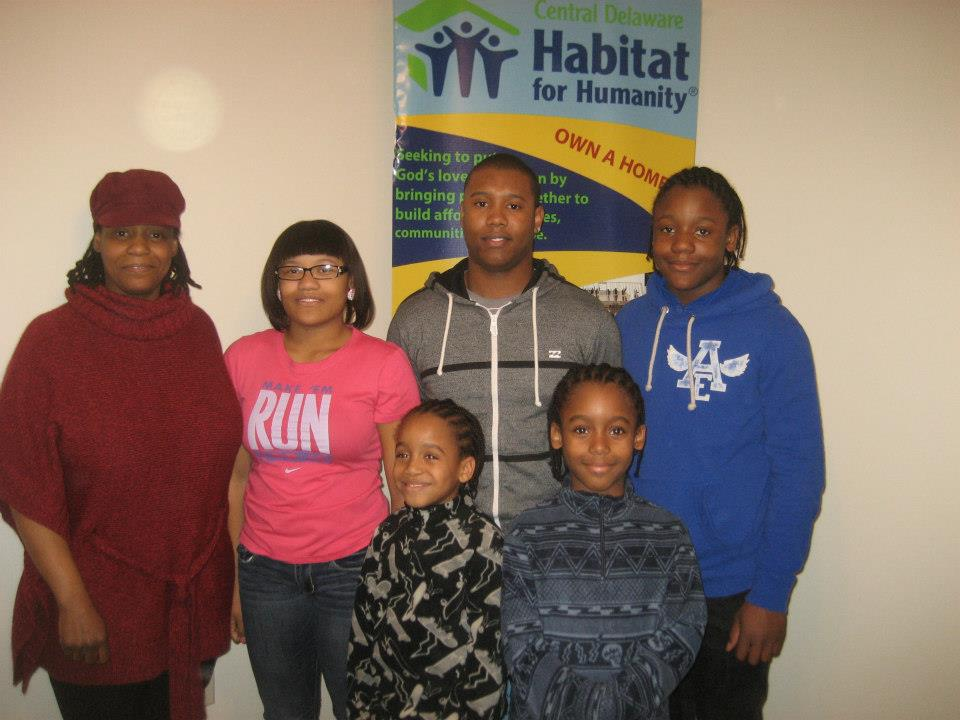 Yolanda Knight (far left) moved her from public housing and bought a home with the help of Habitat for Humanity. Will, then 13, is at far right in blue sweatshirt. (Courtesty of Habitat for Humanity of Kent County)