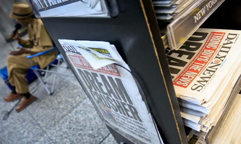 A news stand display copies of the Daily News, Tuesday Sept. 5, 2017, in New York.
