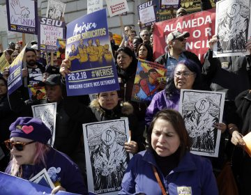 Protesters gather during a demonstration involving various labor union groups Monday, Feb. 26, 2018, in San Francisco. The Supreme Court is divided in a major organized labor case over
