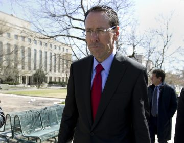AT&T CEO Randall Stephenson leaves the federal courthouse Thursday, March 22, 2018, in Washington.