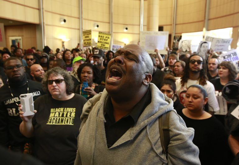 Demonstrators gather outside the entrance to the Sacramento City Council chambers to protest the shooting death of Stephon Clark by Sacramento police, Tuesday, March 27, 2018, in Sacramento,