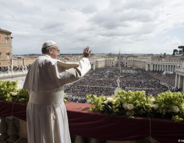 Pope Francis delivers the Urbi et Orbi (to the city and to the world) blessing at the end of the Easter Sunday Mass in St. Peter's Square at the Vatican, Sunday, April 1, 2018. (Vatican Media via AP)