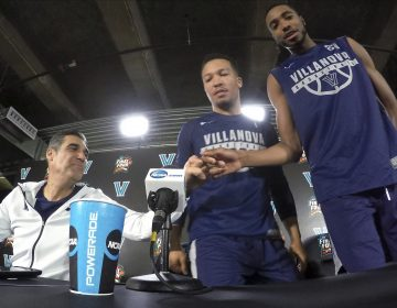 Villanova head coach Jay Wright, left, bumps his fist with Mikal Bridges as Jalen Brunson, center, and Bridges arrive at a news conference with head coach Jay Wright, left, and Mikal Bridges for the championship game of the Final Four NCAA college basketball tournament against Michigan, Sunday, April 1, 2018, in San Antonio.