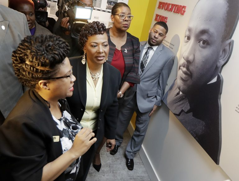 Rev. Bernice King, second from left, daughter of the late civil rights leader Rev. Martin Luther King Jr., tours an exhibit at the National Civil Rights Museum, Monday, April 2, 2018, in Memphis, Tenn. The museum was formerly the Lorraine Motel, where Rev. Martin Luther King Jr. was assassinated April 4, 1968. (AP Photo/Mark Humphrey)