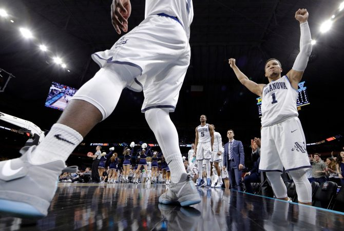 Villanova's Jalen Brunson (1) and players on Villanova bench react during the second half in the championship game of the Final Four NCAA college basketball tournament against Michigan, Monday, April 2, 2018, in San Antonio. (AP Photo/David J. Phillip)