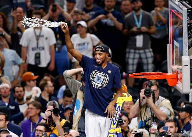 Villanova guard Mikal Bridges celebrates after cutting down the net after the championship game against Michigan in the Final Four NCAA college basketball tournament, Monday, April 2, 2018, in San Antonio. Villanova won 79-62. (AP Photo/Brynn Anderson)