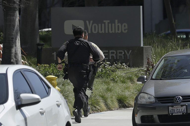 Officers run toward a YouTube office in San Bruno, Calif., Tuesday, April 3, 2018. Police say they're responding to an active shooter at YouTube headquarters.