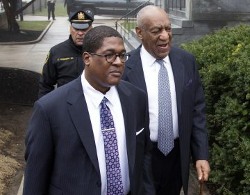 Bill Cosby, right, arrives for his sexual assault case spokesperson Andrew Wyatt, center, at the Montgomery County Courthouse, Wednesday, April 4, 2018, in Norristown, Pa.