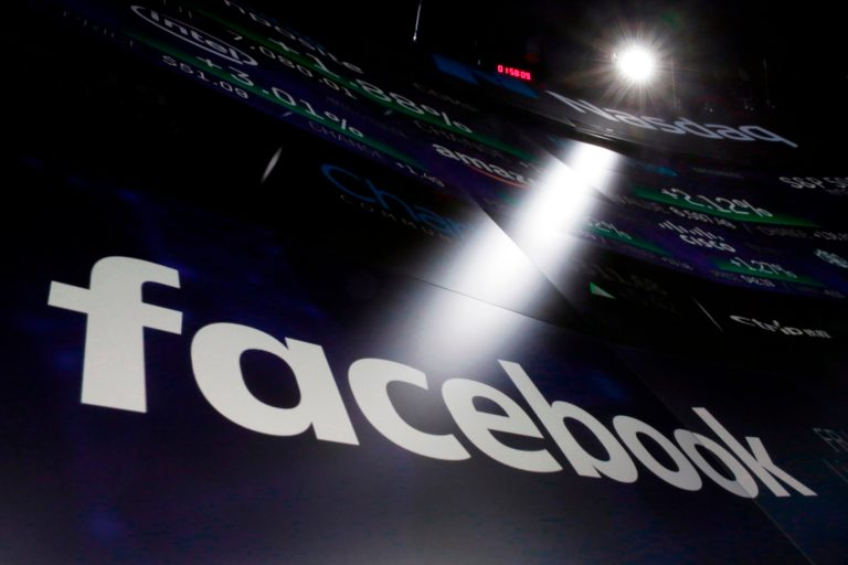 In this March 29, 2018, file photo, the logo for Facebook appears on screens at the Nasdaq MarketSite in New York's Times Square. Facebook CEO Mark Zuckerberg is set to testify before a House oversight panel on April 11 as Congress and U.S. regulators consider how to deal with the social media giant amid a privacy scandal. (Richard Drew/AP Photo, File)