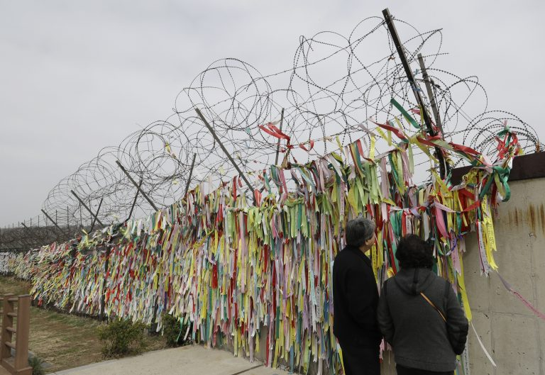 Visitors look at the ribbons carrying messages wishing the reunification and peace of the two Koreas at the Imjingak Pavilion in Paju, South Korea, Saturday, April 7, 2018. North and South Korea have held talks over establishing a telephone hotline between their leaders and other communication issues ahead of a rare summit between the rivals later this month. (Lee Jin-man/AP Photo)