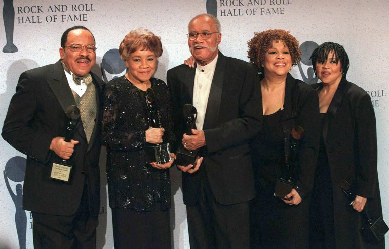 FILE - This March 15, 1999 file photo shows the sibling group The Staples Singers, from left, Pervis, Cleotha, Pops, Mavis, and Yvonne at the Rock and Roll Hall of Fame induction ceremony in New York. Yvonne Staples, whose voice and business acumen powered the success of her family's Staples Singers gospel group, has died at age 80. The Chicago funeral home Leak and Sons says that she died Tuesday, April 10, 2018 at home in Chicago. (AP Photo/Albert Ferreira, file)