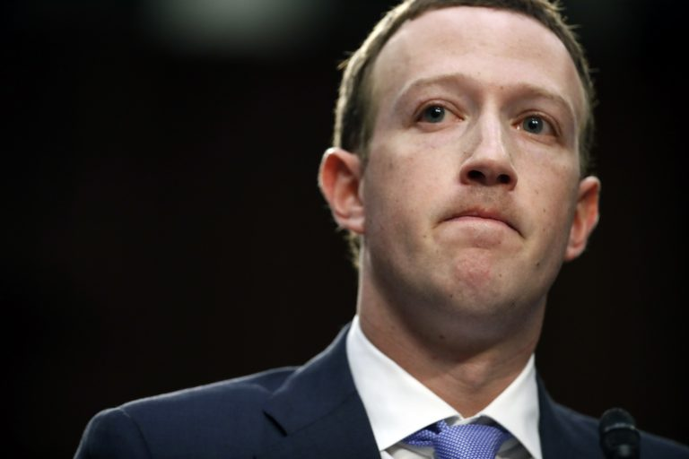 Facebook CEO Mark Zuckerberg pauses while speaking as he testifies before a joint hearing of the Commerce and Judiciary Committees on Capitol Hill in Washington, Tuesday, April 10, 2018