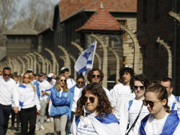 A group of Israeli youth visit the former Nazi German death camp of Auschwitz ahead of the yearly March of the Living, a Holocaust remembrance march, in Oswiecim, Poland, on April 12, 2018. (Czarek Sokolowski/AP Photo)