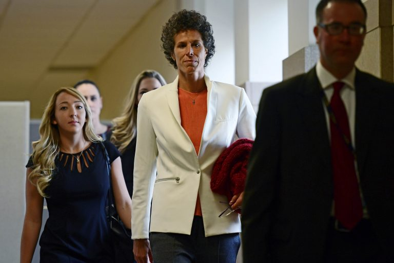 Andrea Constand, center, walks into a courtroom for Bill Cosby's sexual assault trial at the Montgomery County Courthouse, Friday, April 13, 2018, in Norristown, Pa. Constand, Bill Cosby's chief accuser, will take the witness stand on Friday.