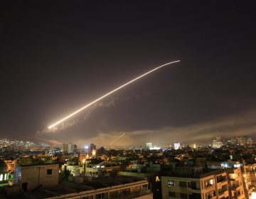 The Damascus sky lights up missile fire as the U.S. launches an attack on Syria targeting different parts of the capital early Saturday, April 14, 2018. Syria's capital has been rocked by loud explosions that lit up the sky with heavy smoke as U.S. President Donald Trump announced airstrikes in retaliation for the country's alleged use of chemical weapons. (Hassan Ammar/AP Photo)