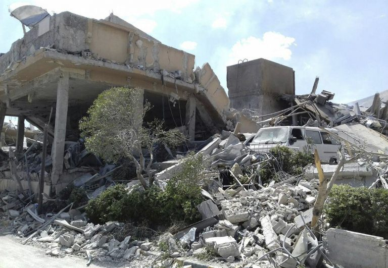 In this photo released by the Syrian official news agency SANA, shows the damage of the Syrian Scientific Research Center which was attacked by U.S., British and French military strikes to punish President Bashar Assad for suspected chemical attack against civilians, in Barzeh, near Damascus, Syria, Saturday, April 14, 2018. A Syrian military statement said in all, 110 missiles were fired by the U.S., Britain and France and that most of them were shot down or derailed. Russia's military said Syrian air defense units downed 71 out of 103 cruise missiles launched by the U.S. and its allies. (SANA via AP)