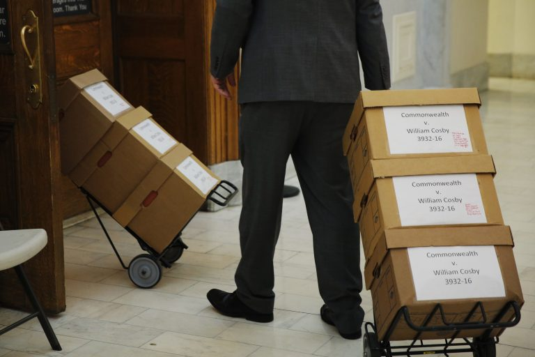 Boxes of documents are wheeled into the courtroom before actor and comedian Bill Cosby arrives for his sexual assault retrial at the Montgomery County Courthouse in Norristown, Pa., Monday, April 16, 2018.