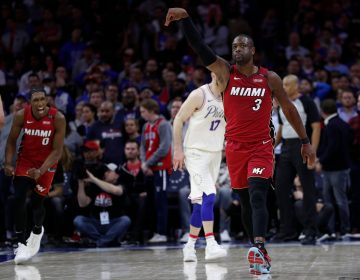 Miami Heat's Dwyane Wade reacts to his basket in the last minute of the second half in Game 2 of a first-round NBA basketball playoff series against the Philadelphia 76ers, Monday, April 16, 2018, in Philadelphia. The Heat won 113-103. (AP Photo/Chris Szagola)