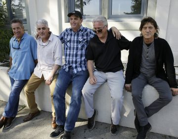 In this Friday, April 13, 2018, photo, the Waldos, from left, Mark Gravitch, Larry Schwartz, Dave Reddix, Jeffrey Noel and Steve Capper sit on a wall they used to frequent at San Rafael High School in San Rafael, Calif. Friday is April 20, or 4/20. That's the numerical code for marijuana's high holiday, a celebration and homage to pot's enduring and universal slang for smoking. And the five Northern California high school stoner buddies widely credited with creating the shorthand slang for getting high nearly 50 years ago now serve as the day's unofficial grand masters.  (Eric Risberg/AP Photo)