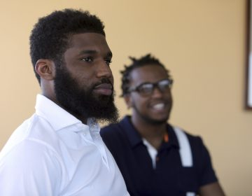 Rashon Nelson, listens to a reporter's question alongside Donte Robinson during an interview with the Associated Press Wednesday April 18, 2018 in Philadelphia.