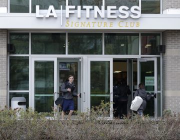 A person leaves an LA Fitness gym while a group of women enter the club, Thursday, April 19, 2018, in Secaucus, N.J. Employees of the LA Fitness wrongly accused a black member and his guest of not paying to work out and called police, prompting an apology from the company. (Julio Cortez/AP Photo)