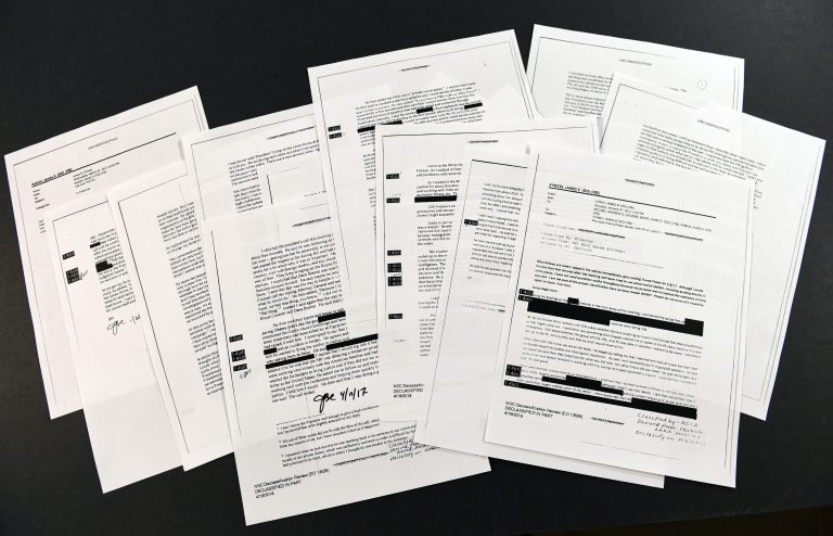 Copies of the memos written by former FBI Director James Comey are photographed in Washington, Thursday, April 19, 2018. President Donald Trump told former FBI Director James Comey that he had serious concerns about the judgment of his first national security adviser, Michael Flynn, according to memos maintained by Comey and obtained by The Associated Press. The 15 pages of documents contain new details about a series of interactions that Comey had with Trump in the weeks before his May 2017 firing. Those encounters include a White House dinner at which Comey says Trump asked him for his loyalty. (Susan Walsh/AP Photo)
