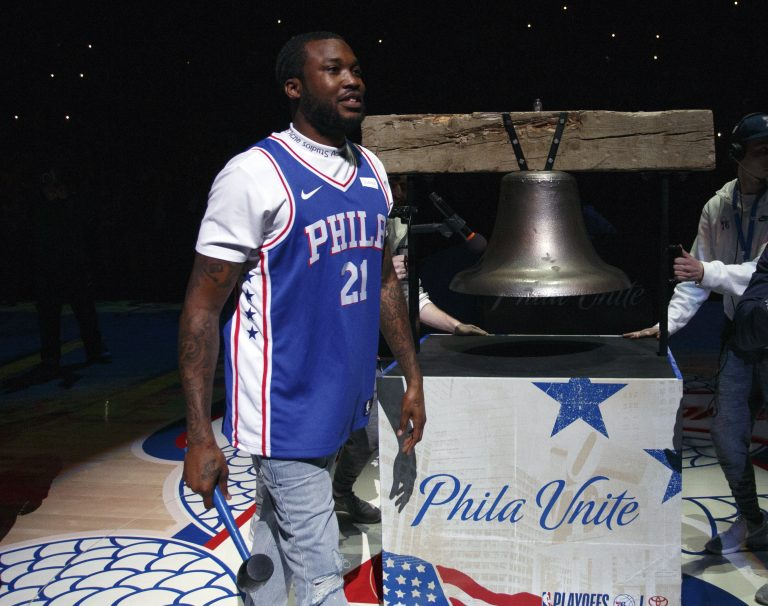 Rapper Meek Mill comes out to ring a Liberty Bell replica before the first half in Game 5 of a first-round NBA basketball playoff series between the Miami Heat and the Philadelphia 76ers, Tuesday, April 24, 2018, in Philadelphia. (AP Photo/Chris Szagola)