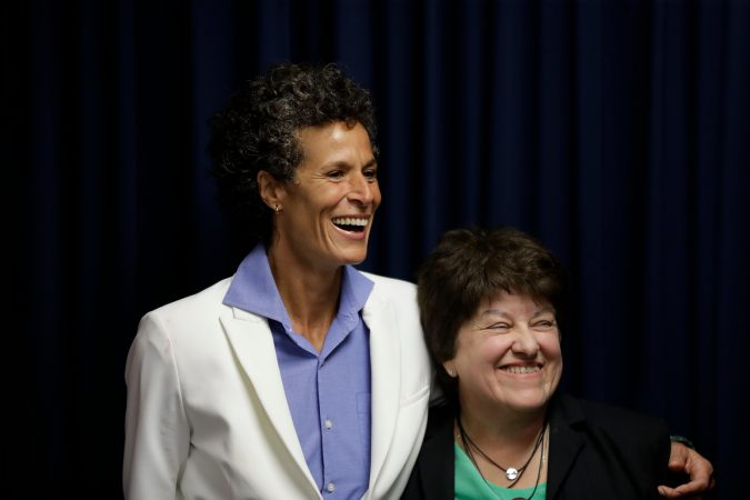 Bill Cosby accuser Andrea Constand, left, and her attorney Dolores Troiani, laugh during a news conference after Cosby was found guilty in his sexual assault trial, Thursday, April 26, 2018, in Norristown, Pa. (AP Photo/Matt Slocum)