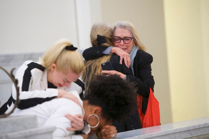 Accuser Lili Bernard, foreground, is consoled by grief counselor Caroline Heldman left, as accuser Victoria Valentino, right, is comforted outside the courtroom after Bill Cosby was found guilty in his sexual assault retrial, Thursday, April, 26, 2018, at the Montgomery County Courthouse in Norristown, Pa. A jury convicted the