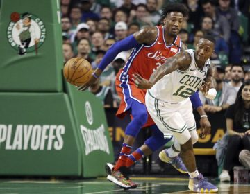 Boston Celtics guard Terry Rozier (12) passes the ball against the defense of Philadelphia 76ers forward Robert Covington (33) in the first quarter of Game 1 of an NBA basketball second-round playoff series, Monday, April 30, 2018, in Boston. (AP Photo/Elise Amendola)