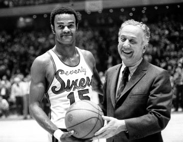 Hal Greer (15), of the Philadelphia 76ers, accepts ball from Sixers owner Irv Koslof