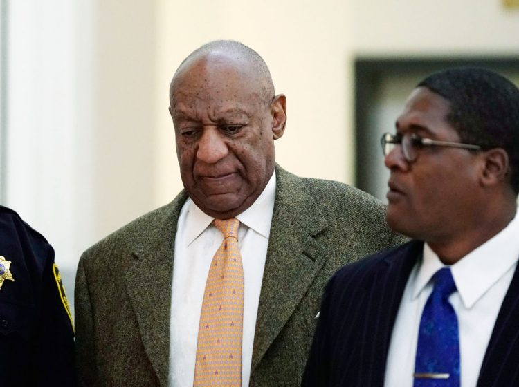 Actor and comedian Bill Cosby, (left), walks with his spokesman Andrew Wyatt, during his sexual assault retrial at the Montgomery County Courthouse in Norristown, Pa., Monday, April 23, 2018. (Jessica Kourkounis/Pool Photo via AP)
