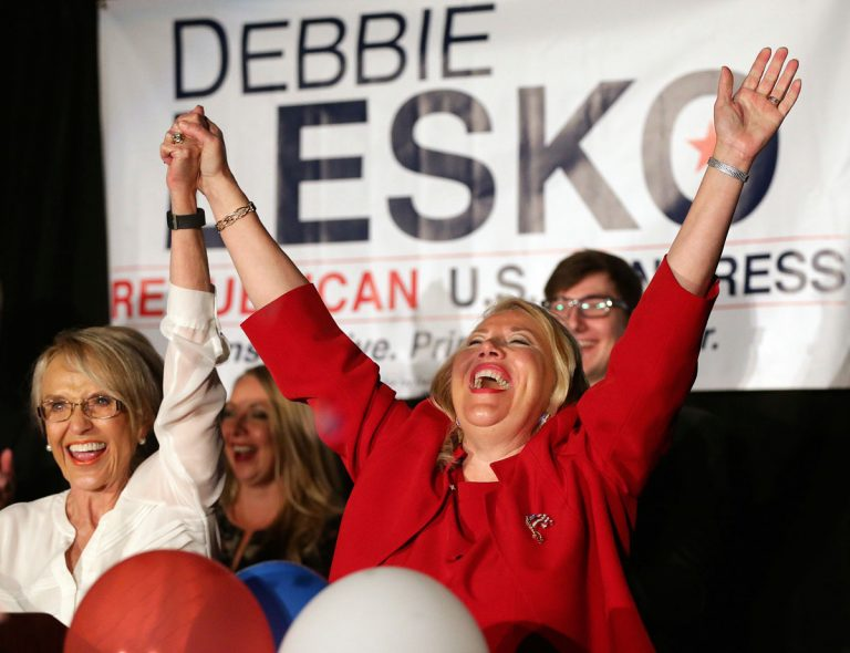 Republican U.S. Congressional candidate Debbie Lesko, right, celebrates her win with former Arizona Gov. Jan Brewer at her home, Tuesday, April 24, 2018, in Peoria, Ariz. Lesko ran against Democratic candidate Hiral Tipirneni for Arizona's 8th Congressional District seat being vacated by U.S. Rep. Trent Franks, R-Arizona. (Matt York/AP Photo)