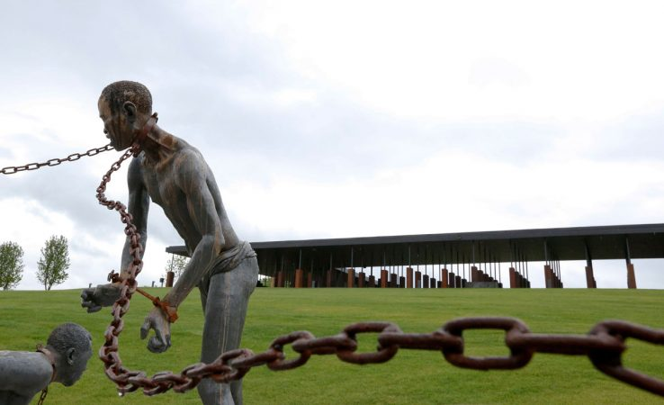 A statue of a of a chained man is on display at the National Memorial for Peace and Justice, the new memorial is opening to honor thousands of people killed in racist lynchings on Sunday, April 22, 2018, in Montgomery, Ala. The Memorial and Justice and the Legacy Museum will open on Thursday. (Brynn Anderson/AP Photo)
