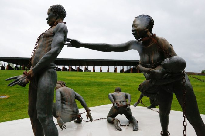 Part of a statue depicting chained people is on display at the National Memorial for Peace and Justice, a new memorial to honor thousands of people killed in racist lynchings, Sunday, April 22, 2018, in Montgomery, Ala. The national memorial aims to teach about America's past in hope of promoting understanding and healing. It's scheduled to open on Thursday. (Brynn Anderson/AP Photo)