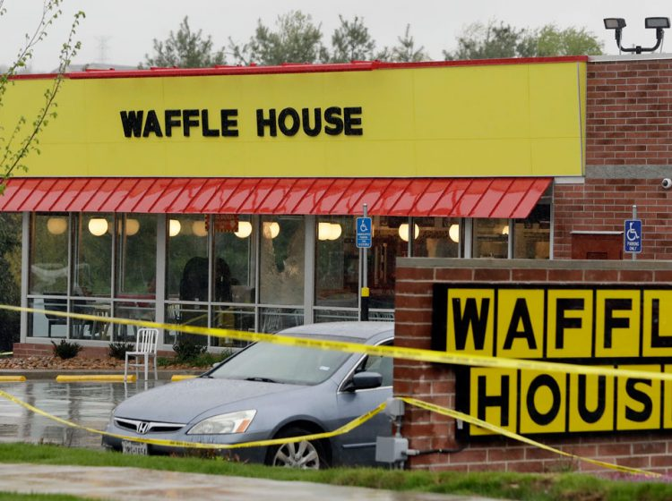 Police tape blocks off a Waffle House restaurant Sunday, April 22, 2018, in Nashville, Tenn. At least four people died after a gunman opened fire at the restaurant early Sunday. (Mark Humphrey/AP Photo)