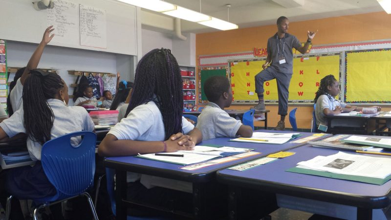 Hayes moves all around the room while teaching, a dynamic presence. (Kevin McCorry/WHYY)