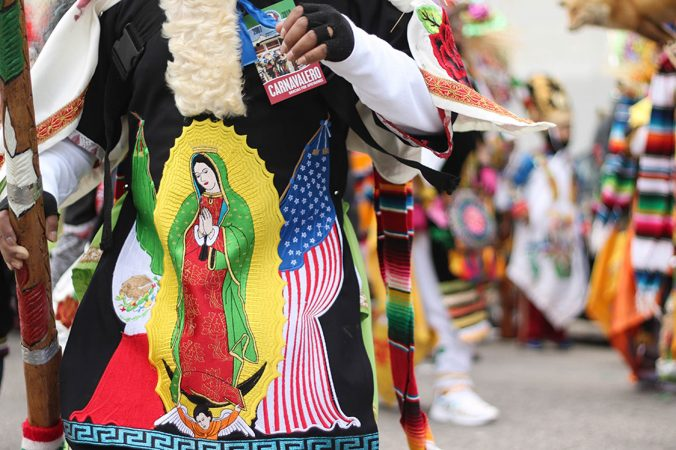 The Virgin of Guadalupe, an iconic image in Mexican culture, adorns the costumes of carnavaleros, the performers in the yearly festival, Carnaval de Puebla. (Angela Gervasi for WHYY)