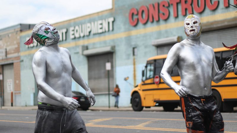 Slicked in silver body paint, performers march down Washington Avenue, cracking whips. The costume is said to symbolize the devil being let loose. (Angela Gervasi for WHYY)