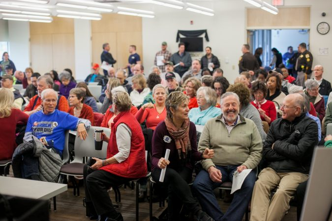 New Castle County residents debate guns and gun policy at a town hall with U.S Sen. Tom Carper and U.S Rep. Lisa Blunt Rochester (both D-Del.) Saturday morning. (Brad Larrison for WHYY)