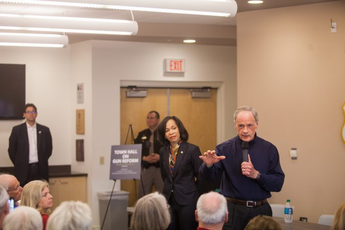 U.S Sen. Tom Carper and U.S Rep. Lisa Blunt Rochester (both D-Del.) lead a town hall on guns and gun policy in New Castle, Del., Saturday morning. (Brad Larrison for WHYY)