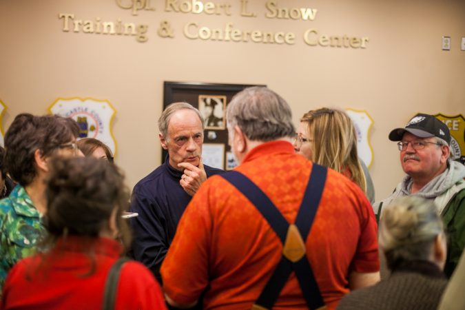 U.S Sen. Tom Carper (D-Del.) speaks with constituents about guns  following a town hall Saturday morning in New Castle. (Brad Larrison for WHYY)