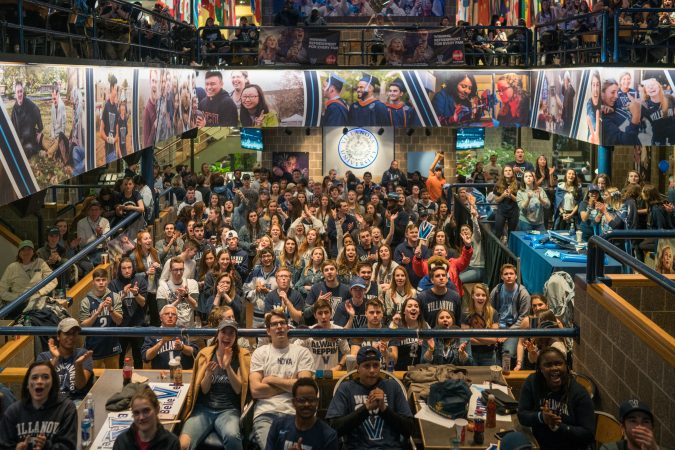 Villanova students gather at the Connelly Center to watch the  men's basketball team play in the NCAA Championship against Michigan. (Branden Eastwood for WHYY)