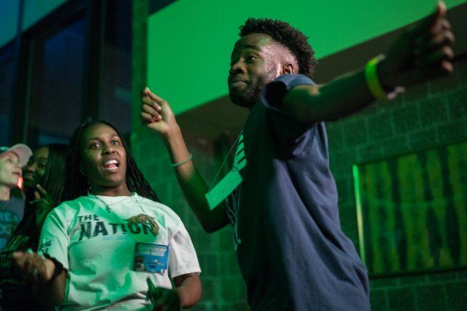 Villanov student Nkiambi Sokolo dances at half time during the NCAA men's basketball championship. (Branden Eastwood for WHYY)