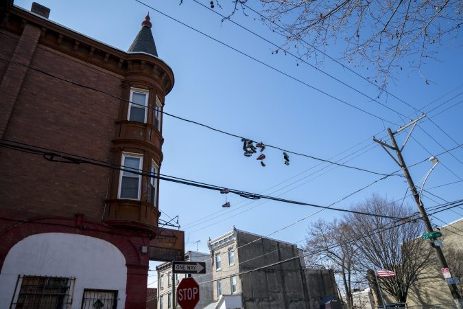 Sneakers hang from electrical wires in Strawberry Mansion. (Jessica Kourkounis/WHYY)