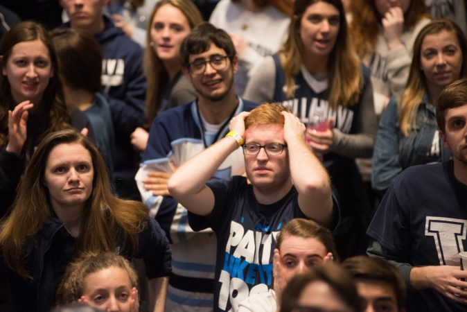 Villanova students respond to a tough start for their team during the NCAA men's basketball championship game. (Branden Eastwood for WHYY)