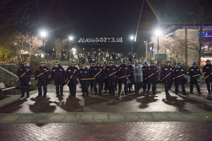 Riot police take move towards a crowd of disruptive students at Villanova Univeristy. (Branden Eastwood for WHYY)