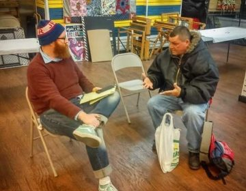 The Renegade Company's Mike Durkin (left) collecting a resident's story (Dennis Payne)