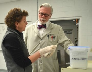Dauphin County Coroner Graham Hetrick and Assistant Chief Deputy Coroner Lynn Choborda discuss blood test results. Like many Pennsylvania counties, Dauphin has had a steady increase in drug overdose deaths. (Brett Sholtis/Transforming Health)