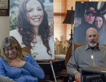 Carol McDowell gets emotional as she and Kevin McDowell sit in front of photos of their daughter Kelly Ann McDowell during a press conference. McDowell killed herself with the service revolver of her boyfriend, Ventnor Police Sgt. Frank O'Neill.